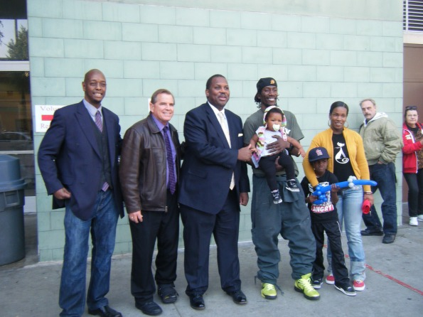From L to R: General Jeff, Skid Row community activist, Rev. Andy Bales, CEO of Union Rescue Mission, State Assemblymember Mike Davis, Crushow and his family, Skid Row community